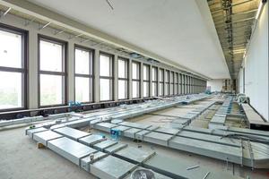 Technischer Ausbau: Montage der Lüftungsleitungen im Ostflügel