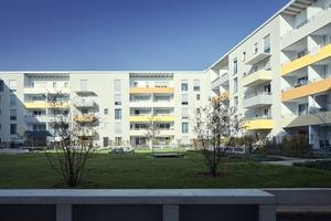 """Die vom Siedlungswerk Nürnberg errichtete, gestalterisch und funktionell eindrucksvolle Wohnanlage """"Am Röthenbacher Landgraben"""" in Nürnberg besteht aus 130 Wohnungen und vier Gewerbeeinheiten"""