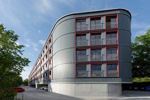 Bei der 100 m langen und 11 m breiten Wohnüberbauung am Dantebad in München setzt der Holzbau auf einem Betontisch auf