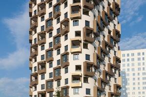 Beim Wohnhochhaus IsarBelle in München nutzen zwei Schindler 5500 den verfügbaren Raum effizient aus