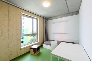 In den Apartments bleibt das Holz der Außenwände sichtbar