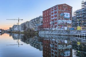 Die direkte Lage am Kanal macht den Reiz des urbanen Wohnens rund um den historischen Kornversuchsspeicher aus