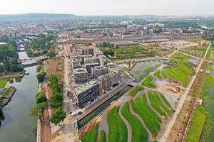 Das Stadtquartier Neckarbogen während der Bauphase. In der Umgebung entstehen die Grünflächen der BUGA 2019
