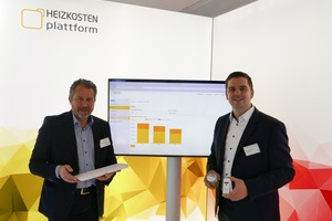 Udo Petzoldt, geschäftsführender Vorstand der Baugenossenschaft Kulmbach eG, und Jan Fredrik Harksen, Geschäftsführer der Zuhause Plattform GmbH, präesentieren die Heizkosten Plattform auf der BAU 2019 in München.
