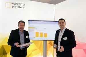 Udo Petzoldt, geschäftsführender Vorstand der Baugenossenschaft Kulmbach eG, und Jan Fredrik Harksen, Geschäftsführer der Zuhause Plattform GmbH, präesentieren die Heizkosten Plattform auf der BAU 2019 in München