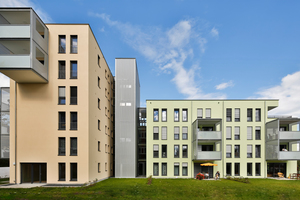 Moderner Wohnungsbau mit Putzfassade in natürlichen Pastellnuancen – hier ausgeführt mit ThermoSan NQG in Gelbgrün und Goldocker