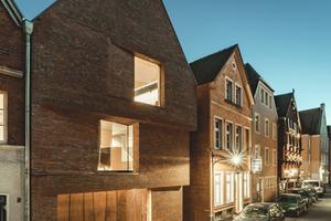 Das Haus am Buddenturm in Münster, ausgezeichnet unter anderem mit dem Architekturpreis Beton, mit dem 1. Preis bei Häuser des Jahres, dem Deutschen Ziegelpreis und dem German Design Award.