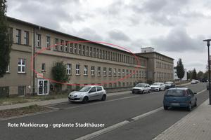 Das einstige Verwaltungsgebäude, das in Stadthäuser umgewandelt wird