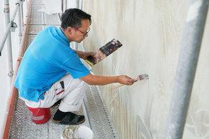 Künstlerische Handwerksarbeit an der Fassade