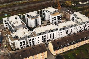 """Der Neubaukomplex """"Ohmgärten"""" umfasst vier Wohngebäude mit insgesamt 100 Wohneinheiten. Die Eigentums- und Sozialwohnungen wurden mit separaten Glasfaserzuleitungen und der TV-Versorgung über ASTRA Satellit 19,2 Grad Ost ausgestattet"""