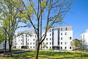 Begrünung und der Erhalt des Baumbestands sind zentrale Elemente der neugestalteten Siedlung Weidenborn in Wiesbaden