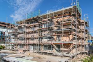 """Beim Neubauprojekt """"Meckelhof II"""" der Familienheim Freiburg e.G. konnte aufgrund des neuen Ziegelleichtputzes auf einen schlankeren Stein zurückgegriffen werden; gleichzeitig wurde das angestrebte KfW-Energieeffizienzniveau erreicht"""