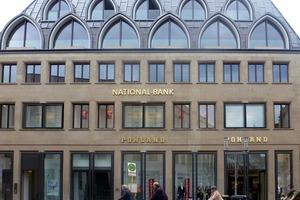 Das ehemalige Bankhaus in Münster hat ein vergrößertes Dach erhalten. Neu sind die Eindeckung aus Walzblei und die Fenstergauben in Spitzbogenform