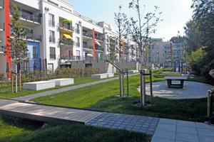 """Der Neubau HeidekampEck der WBG """"Treptow Nord"""" mit seiner großzügigen Gartenanlage"""