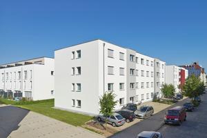 Die Bauformen und die dominierende Fassadenfarbe Weiß unterstreichen den gewünschten homogenen Ausdruck der Klimaschutzsiedlung Paulus-Carrée