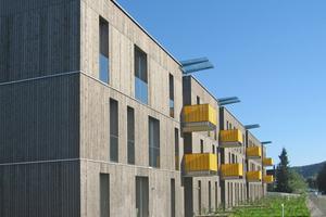 Die Zwischenräume in den beiden Obergeschossen bieten Platz für großzügige Balkonloggien