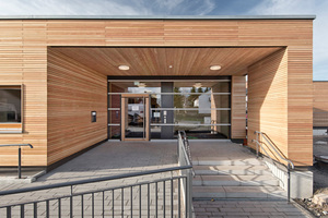 Die Gebäude werden nach individuellen Planungen und Kundenanforderungen gefertigt, hier ein Gebäude mit Holzfassade