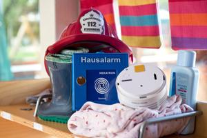 In vielen Kindergärten und Kitas werden Rauchwarnmelder und Funkhandtaster bald ganz selbstverständlich zum Inventar gehören