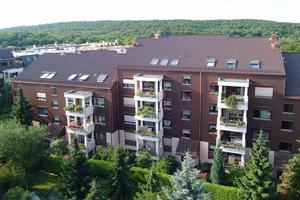 Die Dächer dieser Wohnanlage der Stuttgarter WEG im Stadtteil Weilimdorf wurden mit einer Kombinationsdämmung von Bauder saniert (U-Wert 0,13)