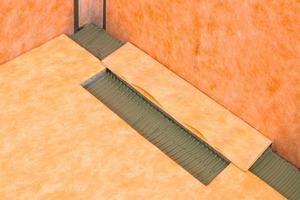 <strong>Schritt 4:</strong> Das Gefälleboard wird unter den Rinnenträger geschoben<br />